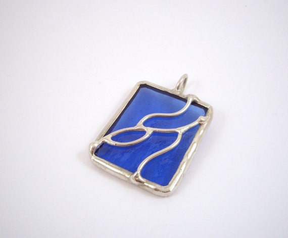 Medium blue stained glass pendant with wire work