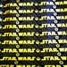 Lucasfilm Ltd Star Wars Movie Logo Yellow on Black premium cotton fabric from Camelot Cottons