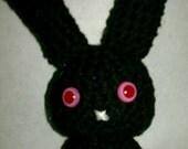 tiny black amigurumi bunny