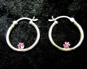 Sterling silver hoop earrings with pink tourmaline accents - the birthstone for October