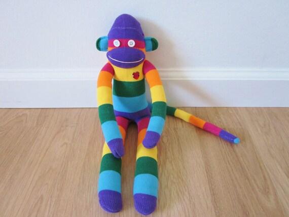 Rainbow striped sock monkey plush with rhinestone heart
