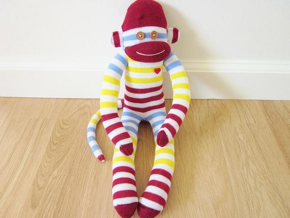Striped sock monkey plush doll - maroon, light blue, yellow, and white