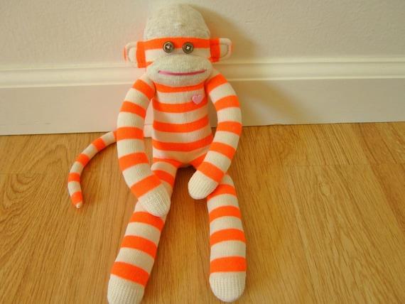 Neon sock monkey plush doll with fluorescent orange and cream stripes