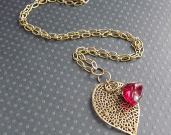 antiqued bronze leaf necklace with garnet red czech glass flower drop