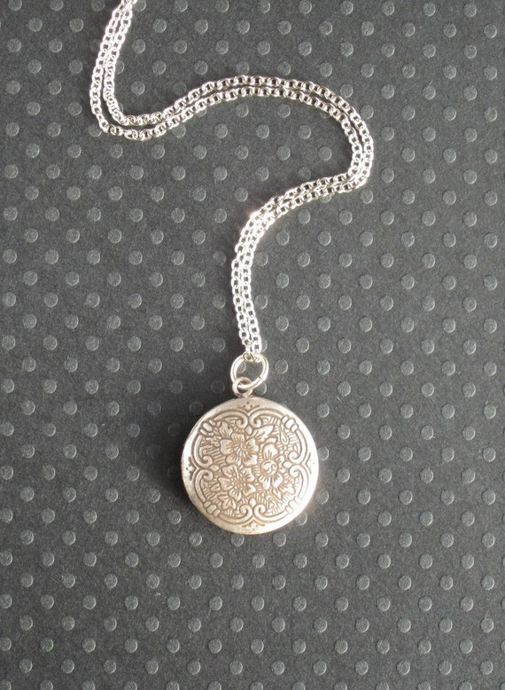 antiqued silver locket / floral necklace