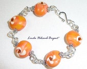 Bracelet of Orange Lampwork Glass Beads