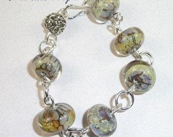 Silver Bracelet of Beige Lampwork Flameworked Glass Beads