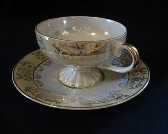 Delicate Glazed Porcelain Teacup and Saucer with Lustre Finish