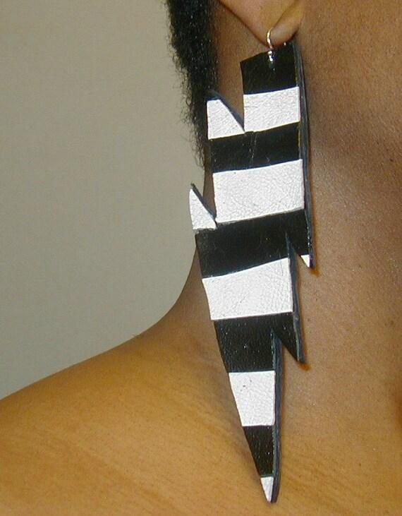 Leather earrings, thunderbolt design.