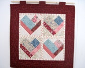 Four hearts aflame hand quilted wall hanging