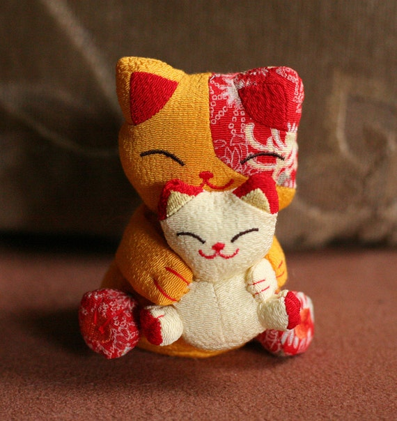 Asian lucky cats - two plush cats hugging