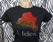 Christmas I Believe With Leopard Print Santa Hat Rhinestone T Shirt