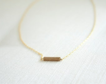 Tiny gold dash necklace