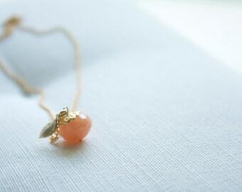 Gold peach gemstone leaf charm necklace