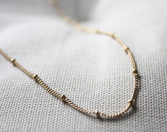 Gold satellite long necklace