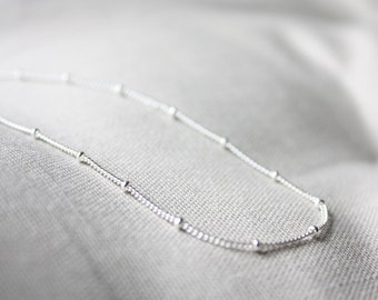 Silver satellite long necklace