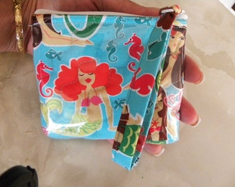 Mermaids water resistant camera case with wristlet.