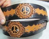 Hand tooled leather peace sign belt, black and tan