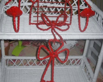 Set of four tole Red wrought iron candle holders and shelf