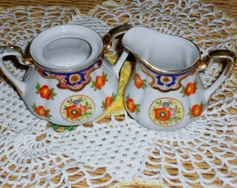 Vintage porcelain creamer and sugar bowl