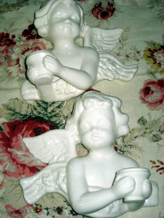 Hollywood regency pair of ceramic angel wall hanging candle holders