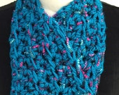 Shaped scarf in rich teal and pink ladder yarn