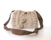 Beige hand knitted messenger bag with adjustable long strap