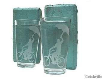 Bicycle Pint glasses, man with umbrella- TWO etched drinking glasses