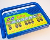 Vintage Blue and Yellow Speak and Music just like Speak & Spell Toy