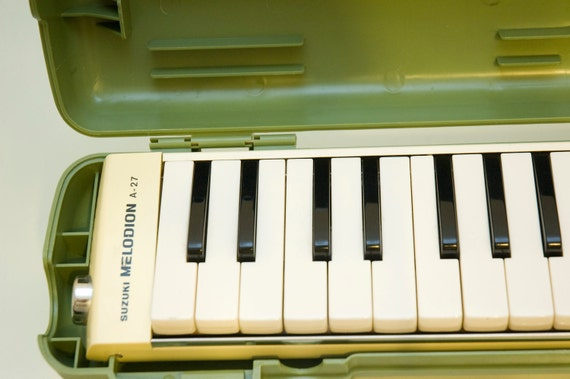 Vintage White Suzuki A-27 Melodica with funky Green Plastic Case