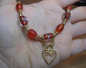 orange and golden heart beaded necklace