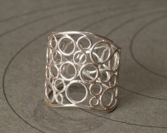 Sterling silver wide ring with little circles size 7