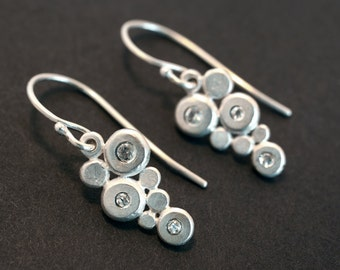 Silver earrings with 6 white sapphires