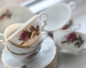 Six baby teacups and saucers, lovely roses and gold rims