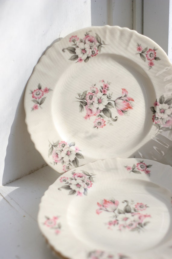 Three bread and butter plates from Aberdeen's 1930s Moss Rose collection