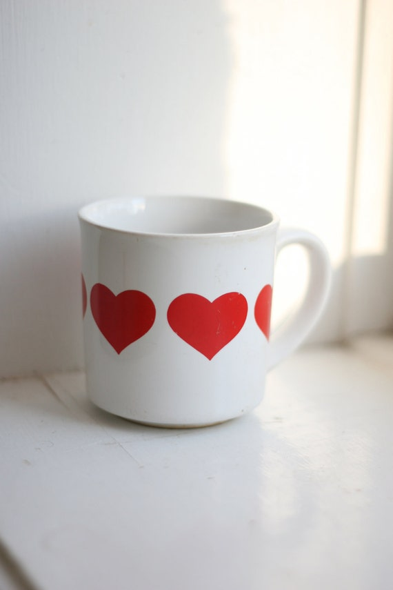 Red hearts on white coffee mug. Perfect morning coffee on Valentine's Day.