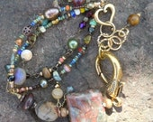 What a Fun Bracelet everything but the kitchen sink as they say And A Giant Clasp too