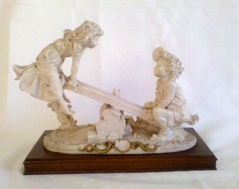 Artist Signed European Boy and Girl on See Saw Stone Sculpture Wood Base