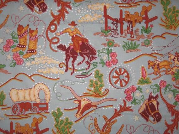 Rhinestone Cowboy on blue Alexander Henry fabric 1 yard