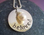 Customized hand stamped sterling silver disc with wrapped pearl