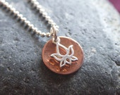 Lotus. Hammered copper disc with sterling silver lotus charm