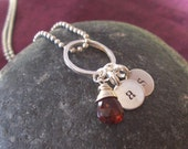 Customized hand stamped necklace with wrapped garnet briolette