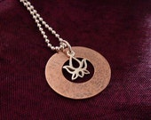 Lotus. Hammered copper washer with sterling silver lotus charm