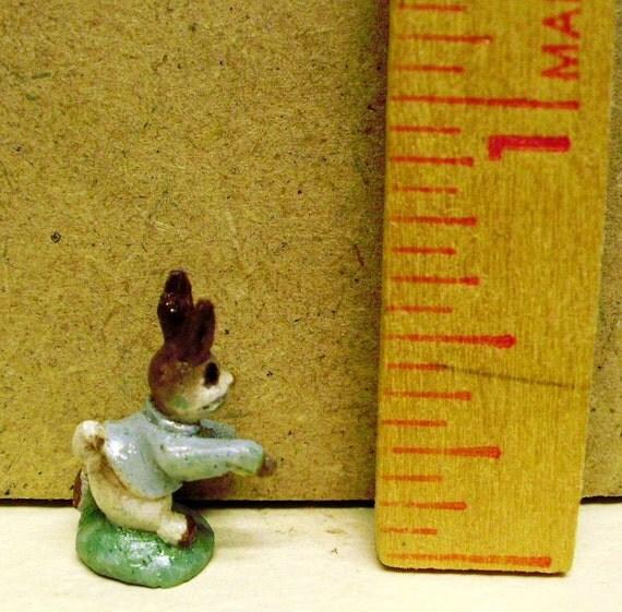 Miniature carved wood Peter Rabbit figurine