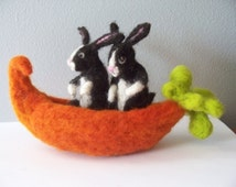Two Dutch Rabbits in a Carrot Canoe Needle felted Rabbits in a boat