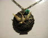 Bird and Flower Locket Necklace - Filigree Antique Bronze Locket with a Brass Bird Charm and Teal Blue Flower