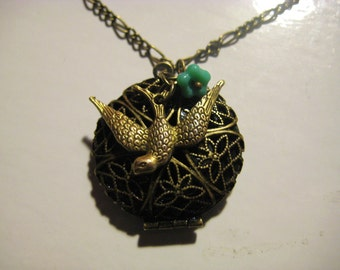 Bird and Flower Locket Necklace - Filigree Antique Bronze Locket with a Brass Bird Charm and Teal Blue Flower
