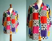 Vintage 80s shirt blouse / multicolor geometric pattern / short sleeves / medium large size plus