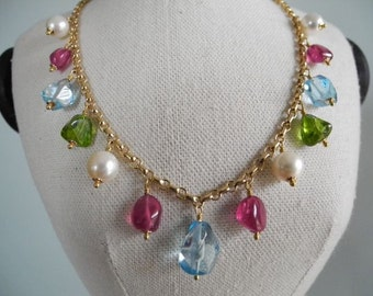Gemstone eye candy with pink ruby dangles