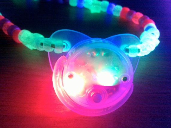 Flashing clear pacifier white glow in the dark and eclectic rainbow kandi raver necklace with white stars